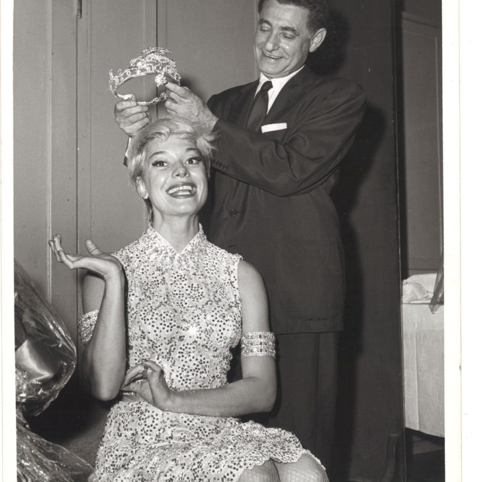 And the winner is -- Leo Robin crowns the diamond tiara on Princess Carol Channing during the tremendous run of the Broadway smash hit Gentlemen Prefer Blondes