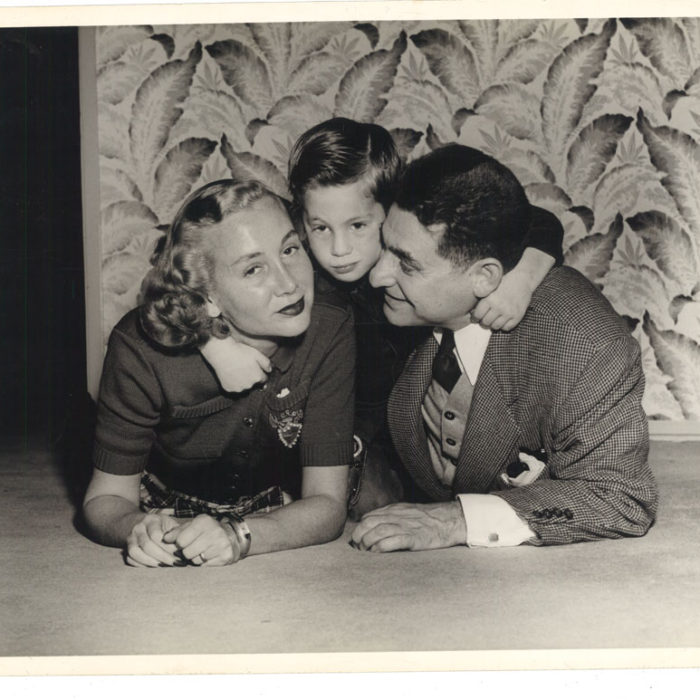 The Robin Family At Home. Leo, his wife and their child Marshall strike a playful pose