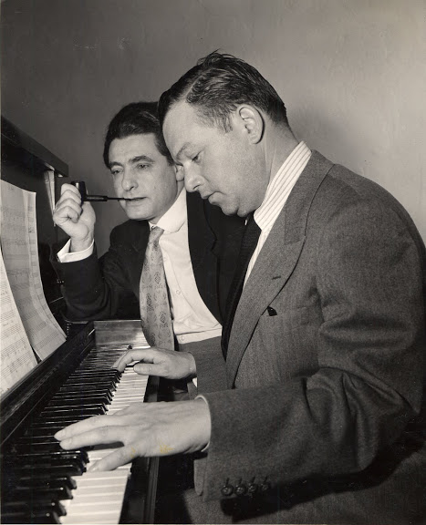 Lyricist Leo Robin with composer Jule Styne in 1949 working on the score for Gentlemen Prefer Blondes.