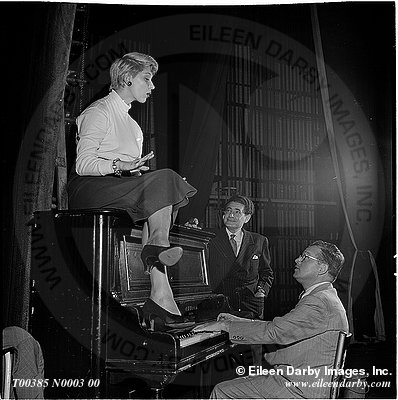 Carol Channing sits atop a piano rehearsing songs with Jule Styne and Leo Robin for the upcoming open of Gentlemen Prefer Blondes on Broadway in 1949