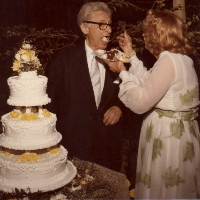 Leo and Cherie Robin celebrate the wedding cake tradition with the bride feeding the groom with the first bite of cake