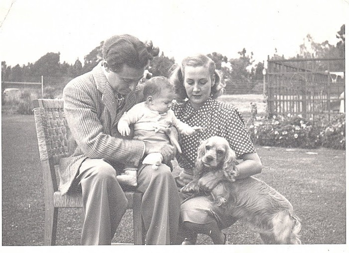 The Young Robin Family at Home. Leo is tenderly holding his new son, Marshall, with his wife, Fran, by their side.  Their pet cocker spaniel strikes a pose, too!