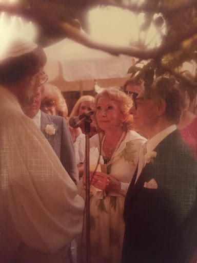 """After being together for more than 25 years, Leo Robin married Cherie Redmond, his longtime accountant and personal assistant.  She had previously worked for the renowned Hecht Hill Lancaster Production Company and later was personal secretary to Marilyn Monroe.  Leo and Cherie are pictured here in her daughter's garden, where they were married on August 26, 1979.  Cherie once said, """"I knew I had to marry the man who wrote such wonderful love songs.""""  At their wedding, Leo sang to her """"If I Should Lose You."""""""