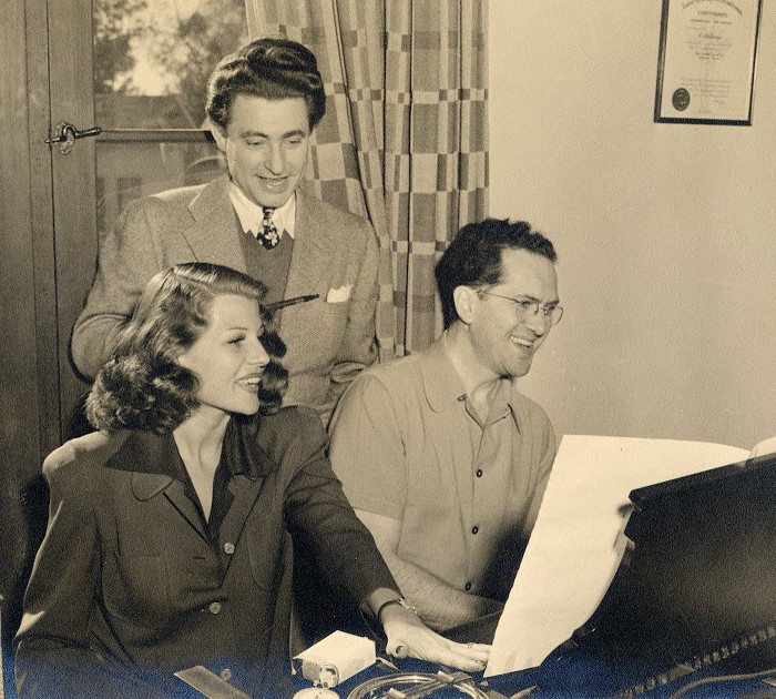 Leo Robin and Ralph Rainger with glamorous film star Rita Hayworth working on My Gal Sal in their bungalow on the Paramount lot in 1942.