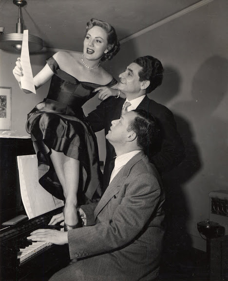 Rehearsing in the studio around the piano in 1951 for Two Tickets to Broadway. Clockwise: film actress Barbara Lawrence, Leo Robin and Jule Styne at the piano.