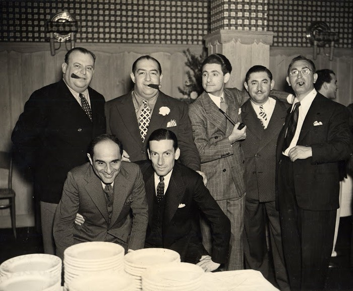 An impressive congregation of songwriters at Hollywood's famed Trocadero nightclub on the Sunset Strip in 1938. Front row from left to right: Lorenz Hart and Hoagy Carmichael. Back row from left to right: Al Dubin, Mack Gordon, Leo Robin, Harry Revel and Harry Warren.