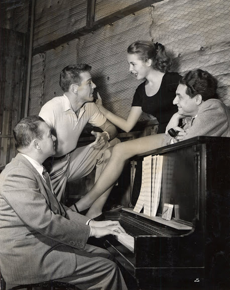 Rehearsing in the studio in 1955 for My Sister Eileen. Clockwise: Jule Styne at the piano; choreographer Gower Champion who was working on a different film for Columbia nearby and apparently dropped by that day to say hi; film actress Janet Leigh and lyricist Leo Robin; Gower and Janet already knew each other since he had helped her with her dancing four years earlier on Two Tickets to Broadway.