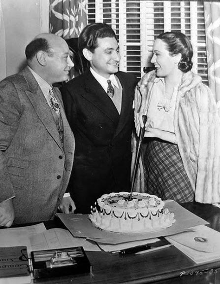 A slice of birthday cake. Actress-Singer Dorothy Lamour and Paramount's music director Boris Morros at Leo Robin's surprise birthday party on April 6, 1938